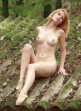 Redhead Mia poses